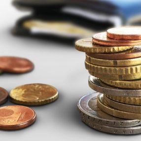 Muntgeld en portemonnee door Christoph Scholz